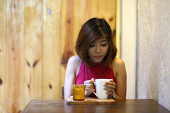 Image of pretty young woman sitting in the cafe and take cup of coffee Stock Photo