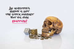 Image of psychology of investing concept. Human skull with dices and money coins and quote about investment risk royalty free stock image