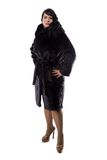Image of pudgy brunette in black coat Stock Photo