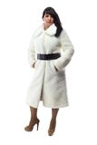 Image of pudgy brunette in long white coat Royalty Free Stock Images