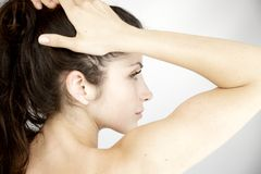 Image of purity of woman holding hair in ponytail Royalty Free Stock Images