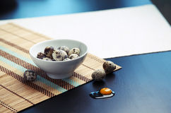 Image of quail eggs in a bowl on table Royalty Free Stock Images