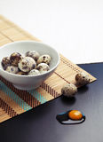 Image of quail eggs in a bowl on a table Stock Photo
