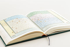 An image of Quran on a white background. The Quran literally meaning 'the recitation' is the central religious text of Islam, which Muslims believe to be the Royalty Free Stock Photo