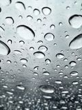 Image of raindrops in great contrast. Rainy season. Rain drops in good contrast for backgrounds and textures of artistic and editing works royalty free stock photo