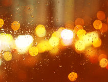 Image of raindrops on window at night in the city Stock Photo