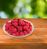 image of raspberries in a bowl on a white background Royalty Free Stock Photo