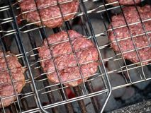 Image of bbq burger patties on grill royalty free stock images
