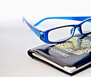 Passport. Image of reading glasses passport on a table
