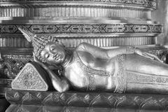 Image of reclining buddha with abstract background Royalty Free Stock Image