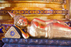 Image of reclining buddha with abstract background Royalty Free Stock Images
