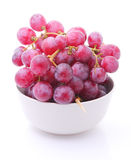 Image of red grape in bowl isolated on white Royalty Free Stock Photo
