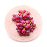 Image of red grape bunch in plate over white Stock Photography