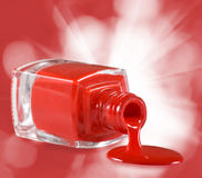 image of red nail polish and heart on a red background Stock Photo