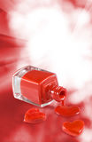image of red nail polish and heart on a red background Royalty Free Stock Photography
