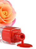 image of red nail polish and heart on a red background Royalty Free Stock Photos