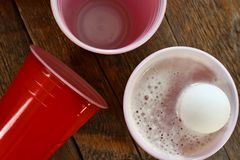 Red Plastic Drinking Cups and Spilled Beer Stock Photos