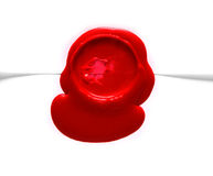 Image of red wax stamp over white Stock Photos