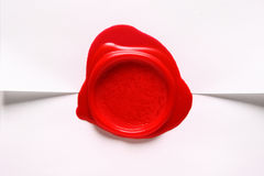 Image of red wax stamp over white paper Stock Photography