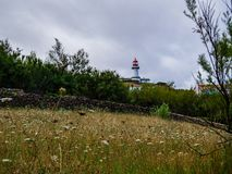 Image of red and white lighthouse during day time royalty free stock photo