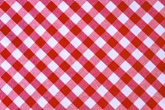 Red and white plaid textile fabric texture for abstract background royalty free stock photography