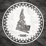 Idaho state map. Image relative to USA travel. Idaho state map textured by lines and dots pattern. Stamp in the shape of a circle royalty free illustration