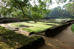 Ancient Palace Floor Plans Ruins in Sigiriya Ruins. An image of remnants of buildings in half walls of stacked brick wall lshows what could be a floor plan to an stock photography