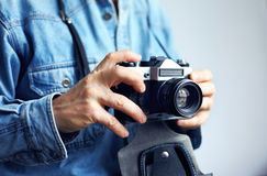 Image of reporter with photo camera Stock Photography