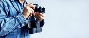 Reporter with film camera Royalty Free Stock Image