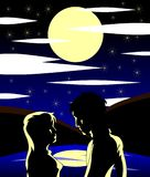 Couple of lovers at lake at night. Image representing a boy and a girl looking romantically at a lake on a starry night. An image to talk about love Stock Photography
