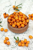 Image of ripe sea-buckthorn berries in wooden bowl Royalty Free Stock Photo