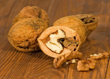 Image of ripe walnuts on the table close-up Royalty Free Stock Images