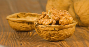 Image of ripe walnuts on the table close-up Royalty Free Stock Photography