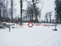 Image of road barrier in the winter in the forest royalty free stock photography