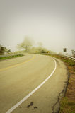 An image of a road covered in fog Stock Images