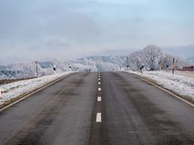 Image of a road in a winter landscape stock image
