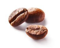 Image of roasted coffee beans over white background Stock Images