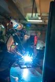 Image of robotic machine welding metal fasteners Stock Photos