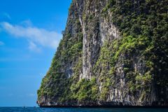 Rocks and vegetation on island in the Andaman sea. Image of a rock formation on an island in the Andaman sea Stock Image
