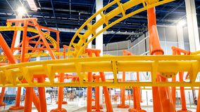 Image of roller coaster with extreme fast loops in big shopping mall. Photo of roller coaster with extreme fast loops in big shopping mall stock images