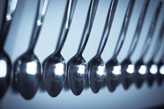 Row of spoons Stock Photos