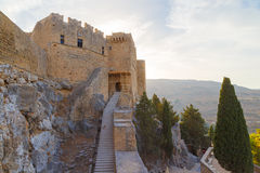 Image of ruins of Lindos castle on Rhodes island in Greece. entrance to the main building Royalty Free Stock Photos