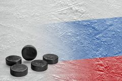 Image of the Russian flag on ice and hockey pucks. Hockey pucks and the image of the Russian flag on the ice. Concept, hockey, background Royalty Free Stock Photo