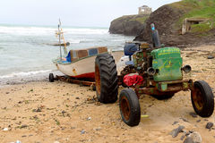 Image an Rusty Tractor With a Boat on the Trailer. At Beach Stock Image