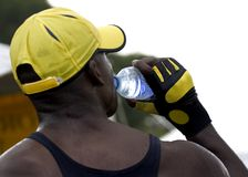 Image's nothing, thirst's everithing. Sweating man drinking fresh clear water after some exercise Stock Images