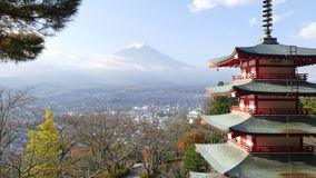 Image of the sacred mountain of Fuji in the background of blue s Stock Photos