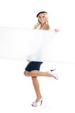 Image of a sailor girl holding a blank poster Royalty Free Stock Photography