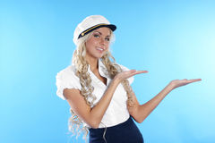Image of a sailor girl showing the right direction Stock Photography