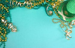 Image for Saint Patrick`s Day on March 17th. A border of green and gold ribbons and beads and a sparkly leprechaun hat stock image