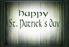 Image for Saint Patrick`s Day on March 17th. A green wooden frame surrounds a green wooden background. Message added. stock image